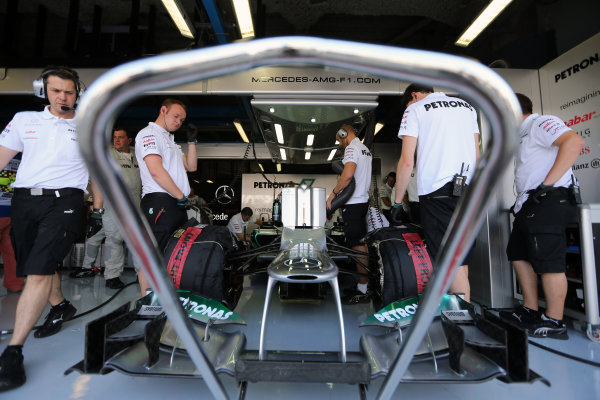 Autodromo Nazionale di Monza, Monza, Italy. 7th September 2012. The Mercedes AMG team work on the car of Michael Schumacher, Mercedes F1 W03, in the garage. World Copyright: Steve Etherington/LAT Photographic ref: Digital Image SNE14406 copy