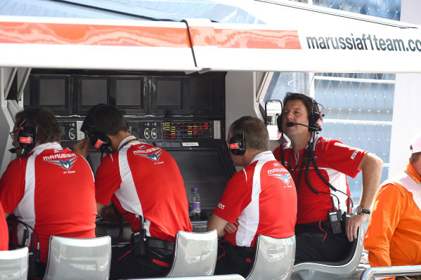 Dave O Neill (GBR) Marussia F1 Team Manager, far right, on the Marussia pit gantry. Formula One World Championship, Rd16, Russian Grand Prix, Qualifying, Sochi Autodrom, Sochi, Krasnodar Krai, Russia, Saturday 11 October 2014.