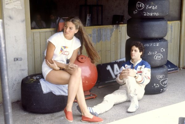 1982 French Grand Prix.Paul Ricard, France. 25 July 1982.Roberto Guerrero, Ensign N181-Ford, did not qualify, portrait, sits next to partner Katie. World Copyright: LAT PhotographicRef: 35mm transparency 82FRA28