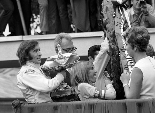 Winner Jackie Stewart (GBR) Matra celebrates his victory and first World Championship with wife Helen (centre). Italian GP, Monza, 8 September 1969.