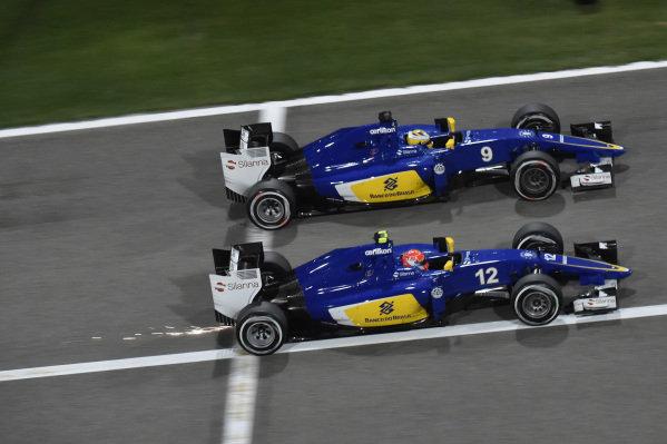 Felipe Nasr (BRA) Sauber C34 and Marcus Ericsson (SWE) Sauber C34 at Formula One World Championship, Rd4, Bahrain Grand Prix Race, Bahrain International Circuit, Sakhir, Bahrain, Sunday 19  April 2015.
