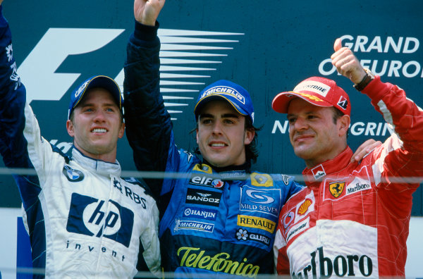 2005 European Grand Prix Nurburgring, Germany. 27th - 29th May. Fernando Alonso, Renault R25 celebrates his victory on the podium with Nick Heidfeld, Williams F1 BMW FW27 and Rubens Barrichello, Ferrari F2005 World Copyright: Peter Spinney/LAT Photographic ref: 35mm Image: 05Monaco01
