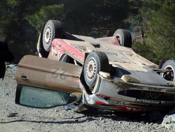 Juuso Pykalisto (FIN) with co-driver Esko Mertalmi (FIN) Bozian Racing Peugeot 206 WRC crash out of the rally.World Rally Championship, Rally of Turkey Day One, Kemer, Turkey, 27 February 2003.DIGITAL IMAGE