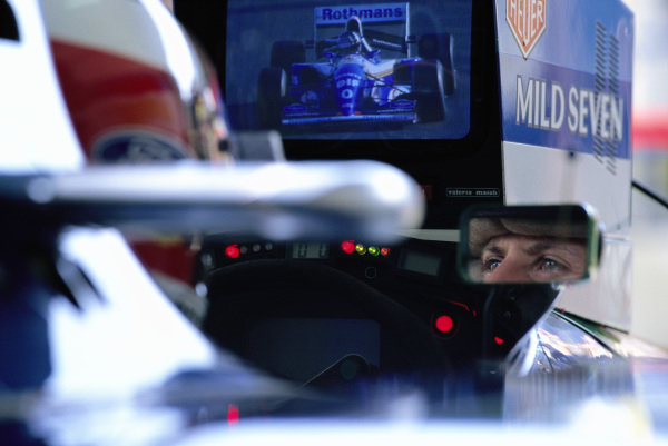 Michael Schumacher watches a monitor showing Damon Hill from the cockpit of his Benetton B194 Ford.