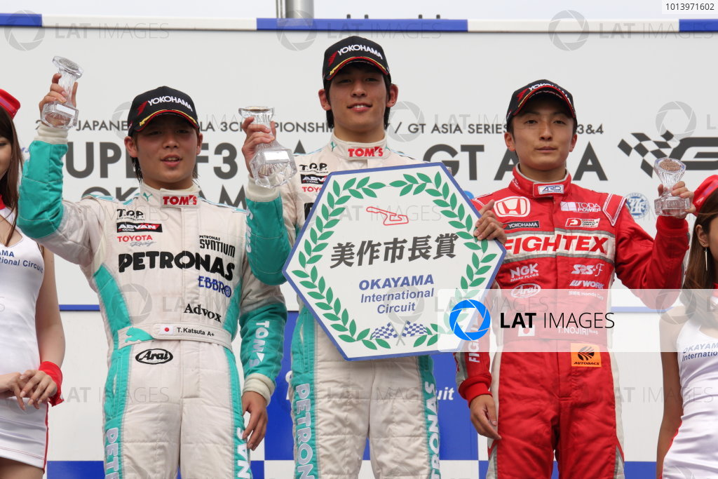 Okayama, Japan. 29th - 30th June 2013 Rd 3 Winner Yuichi Nakayama (Petronas Team TOM'S Spirit) on the podium with Takamoto Katsuta (Petronas Team TOM'S Spirit) and Katsumasa Chiyo (B-MAX Engineering). World Copyright: Yasushi Ishihara/LAT Photographic Ref: Digital Image 2013JF3_Rd7_006