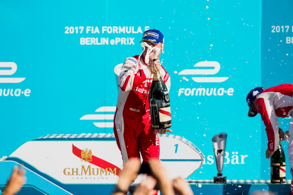 2016/2017 FIA Formula E Championship. Round 7 - Berlin ePrix, Tempelhof Airport, Berlin, Germany. Saturday 10 June 2017.Felix Rosenqvist (SWE), Mahindra Racing, Spark-Mahindra, Mahindra M3ELECTRO, sprays the chanpagne on the podium. Photo: Zak Mauger/LAT/Formula E ref: Digital Image _54I7688