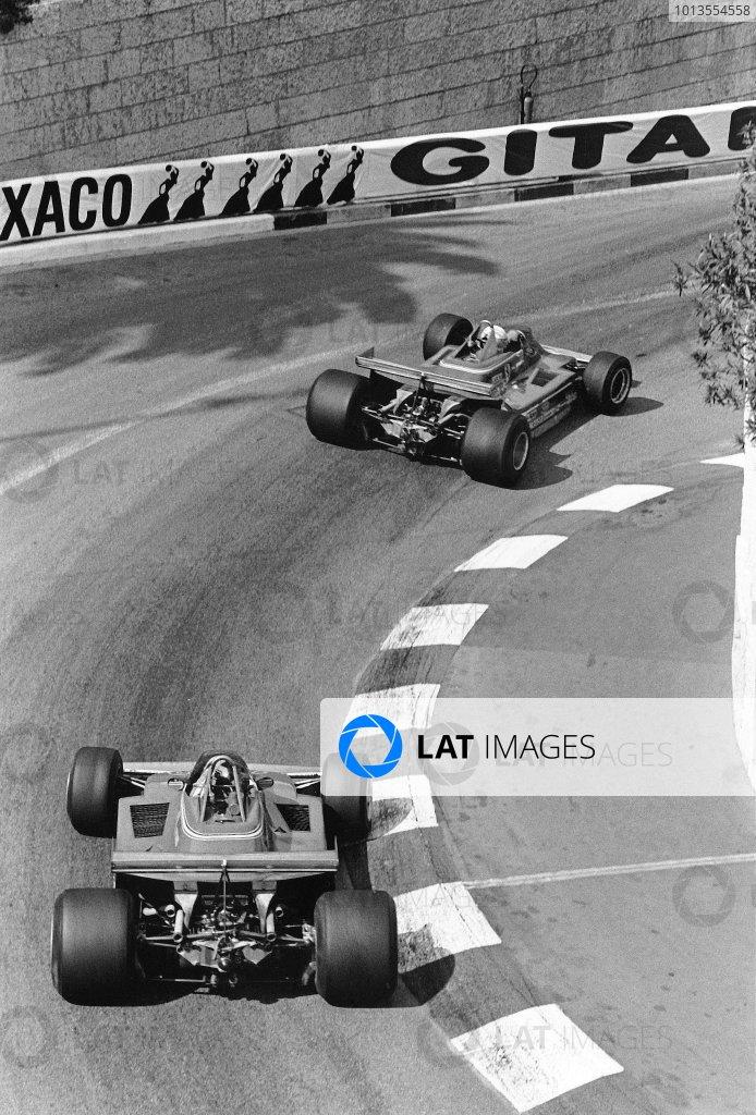 1979 Monaco Grand Prix. Monte Carlo, Monaco. 27 May 1979. Jody Scheckter (Ferrari 312T4) 1st position, leads Gilles Villeneuve (Ferrari 312T4) retired, at Lower Mirabeau, action.  World Copyright: LAT Photographic Ref: 12536/23.