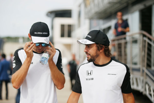 Silverstone, Northamptonshire, England. Friday 03 July 2015. Jenson Button, McLaren, with Fernando Alonso, McLaren. World Copyright: Glenn Dunbar/LAT Photographic. ref: Digital Image _89P1386