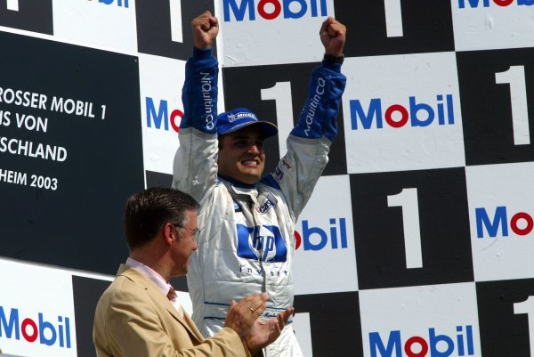 Race winner Juan Pablo Montoya (COL) Williams celebrates on the podium.