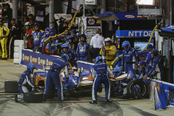 Felix Rosenqvist, Chip Ganassi Racing Honda pits for a new front wing after clipping Sage Karam, Carlin Chevrolet