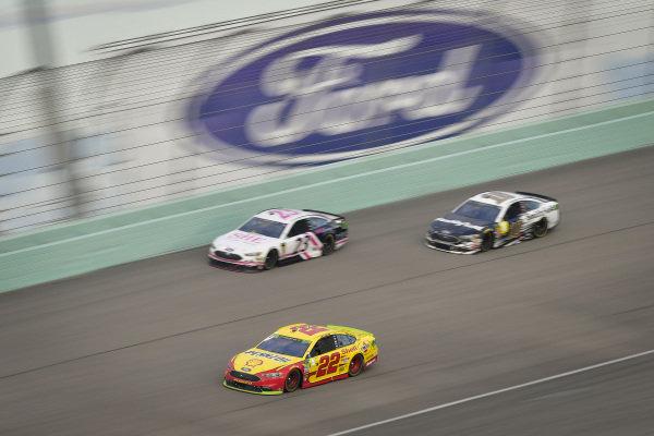 #22: Joey Logano, Team Penske, Ford Fusion Shell Pennzoil, #23: J.J. Yeley, BK Racing, Ford Fusion She Beverage Company, #10: Aric Almirola, Stewart-Haas Racing, Ford Fusion Smithfield