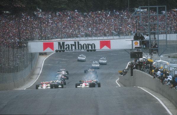 1990 Brazilian Grand Prix.Interlagos, Sao Paulo, Brazil.23-25 March 1990.Poleman Ayrton Senna and teammate Gerhard Berger (both McLaren MP4/5B Honda's) lead the field away from the grid at the start. Ref-90 BRA 07.World Copyright - LAT Photographic
