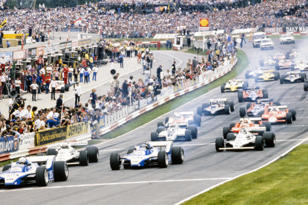 Didier Pironi, Ligier JS11/15 Ford, leads Alan Jones, Williams FW07B Ford, Jacques Laffite, Ligier JS11/15 Ford, Carlos Reutemann, Williams FW07B Ford, Nelson Piquet, Brabham BT49 Ford, and Bruno Giacomelli, Alfa Romeo 179, off the line at the start.
