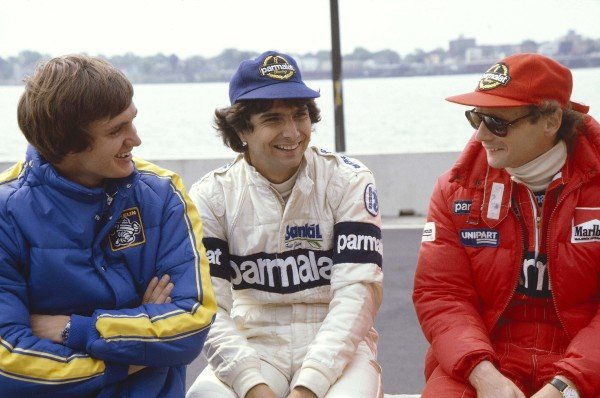 1982 United States Grand Prix East.Detroit, Michigan, USA.4-6 June 1982.Eddie Cheever (Ligier Matra), Nelson Piquet (Brabham BMW) and Niki Lauda (McLaren Ford) have a chat.Ref-82 USA 05.World Copyright - LAT Photographic