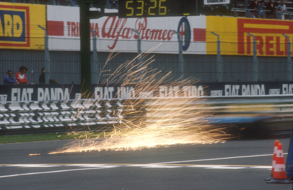 1990 Italian Grand Prix.Monza, Italy.7-9 September 1990.A benetton B190 Ford sends up a shower of sparks.Ref-90 ITA 06.World Copyright - LAT Photographic