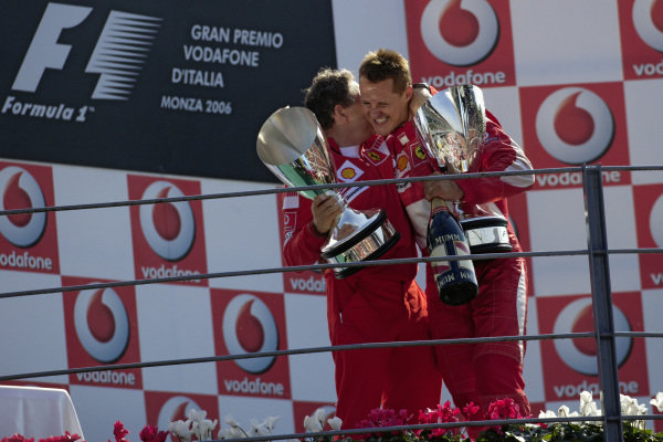 Jean Todt hugs winner Michael Schumacher on the podium as they celebrate a home win for the team.