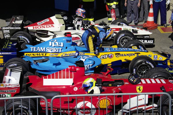 The top three cars in parc fermé: Felipe Massa's winning Ferrari 248 F1, Fernando Alonso getting out of his Renault R26 in 2nd and Jenson Button in 3rd with his Honda RA106.