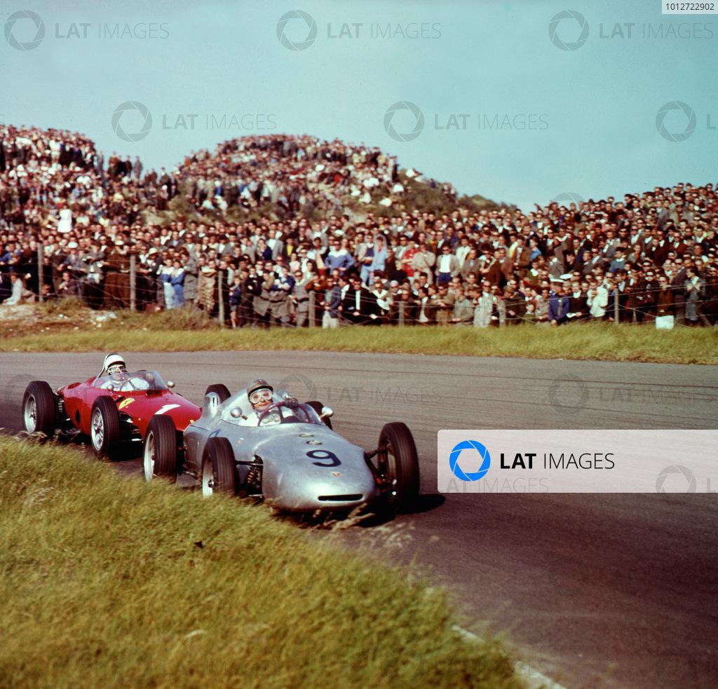 1961 Dutch Grand Prix.Zandvoort, Holland.20-22 May 1961.Hans Herrmann (Porsche 718) leads Phil Hill (Ferrari Dino 156). Hill finished in 2nd position.Ref-3/0279.World Copyright - LAT Photographic
