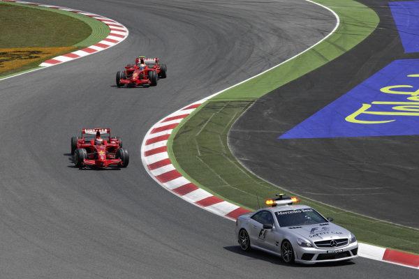 Kimi Räikkönen, Ferrari F2008 leads Felipe Massa, Ferrari F2008 behind the safety car.
