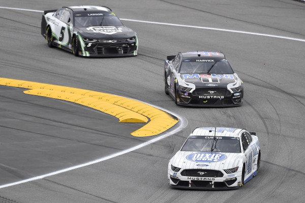#41: Cole Custer, Stewart-Haas Racing, Ford Mustang Dixie Vodka, #4: Kevin Harvick, Stewart-Haas Racing, Ford Mustang Mobil 1, and #5: Kyle Larson, Hendrick Motorsports, Chevrolet Camaro NationsGuard