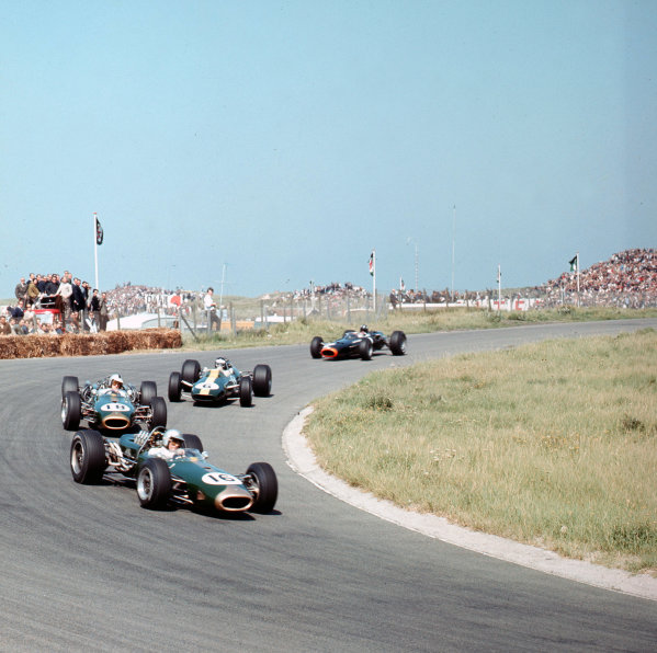 Zandvoort, Holland.22-24 July 1966.Jack Brabham (Brabham BT19 Repco) leads Denny Hulme (Brabham BT20 Repco), Jim Clark (Lotus 33 Climax) and Graham Hill (BRM P261). Brabham, Hill and Clark finished in 1st, 2nd and 3rd positions respectively.Ref-3/2304.World Copyright - LAT Photographic