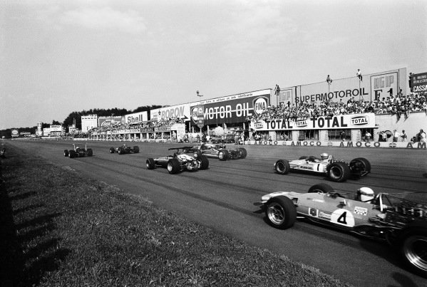 Pole sitter John Surtees, Honda RA301 driving side-by-side with Bruce McLaren, McLaren M7A Ford. Behind them Amon's Ferrari 312, Hill's Lotus 49B Ford and Ickx' Ferrari 312. Currently 6th is Denny Hulme, McLaren M7A Ford followed by Jackie Stewart, Matra MS10 Ford.