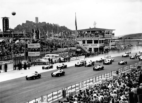 1958 German Grand Prix.  Nurburgring, Germany. 3rd August 1958. The cars leave the grid for the start of the grand prix. Action.  World Copyright: LAT Photographic. Ref: 1958 German Grand Prix.