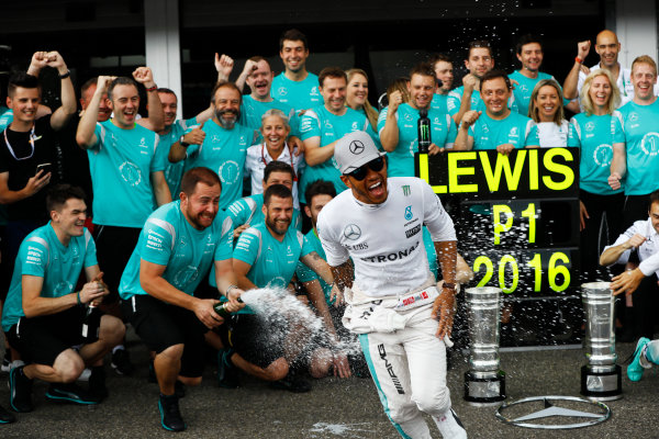Hockenheim, Germany. Sunday 31 July 2016. Team members spray Lewis Hamilton, Mercedes AMG, with champagne after his victory in the German Grand Prix. World Copyright: Andrew Hone/LAT Photographic ref: Digital Image _ONY1526