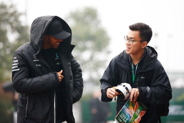 Shanghai International Circuit, Shanghai, China.  Thursday 06 April 2017. Lewis Hamilton, Mercedes AMG, speaks to a fan. World Copyright: Andy Hone/LAT Images ref: Digital Image _ONY3401
