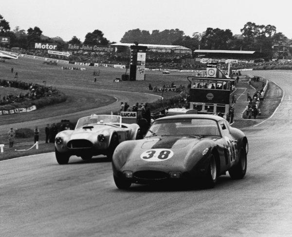 Brands Hatch, England. 11th July 1964.David Piper (Ferrari 250 GTO lowline), 4th position leads Roy Salvadori (A C. Cobra), 3rd position, action. World Copyright: LAT Photographic.Ref:  B/W Print