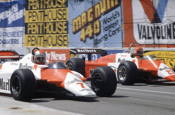1982 United States Grand Prix West.Long Beach, California, USA. 2-4 April 1982.John Watson (#7 McLaren MP4/1B-Ford Cosworth) and Bruno Giacomelli (Alfa Romeo 182). Watson finished in 6th position.World Copyright: LAT PhotographicRef: 35mm transparency 82LB28