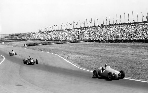 """1955 British Grand Prix Aintree, Great Britain. 16 July 1955.""""Mike Sparken"""" (Gordini 16) leads Horace Gould (Maserati 250F) and Hermanos da Silva Ramos (Gordini 16) passed the horse racing fences Ref: Published """"Autocar"""" 22/7/1955World Copyright: LAT Photographic"""