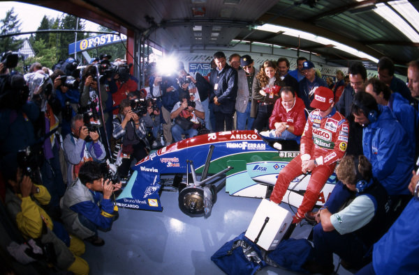 Rubens Barrichello (BRA) Jordan sits in the garage surrounded by the media during Qualifying having set pole position time. Formula One World Championship, Rd11, Belgian Grand Prix,  Spa-Francorchamps, Belgium, 28 August 1994.