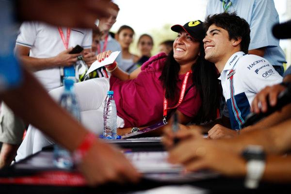 Baku City Circuit, Baku, Azerbaijan. Friday 23 June 2017. Lance Stroll, Williams Martini Racing, poses for a picture with a fan. World Copyright: Glenn Dunbar/LAT Images ref: Digital Image _31I9741
