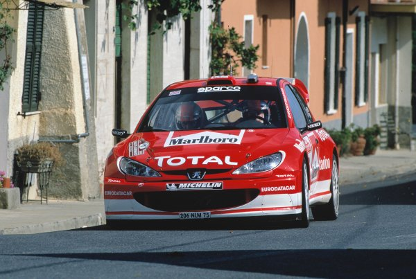 2003 World Rally ChampionshipRally of San Remo, Italy. 2nd - 5th October 2003.Richard Burns / Robert Ried, Peugeot 206 WRC. Street, Action.World Copyright: McKLEIN/LATref: 35mm Image WRCSANREMO06 jpg
