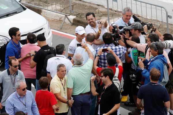 Interlagos, Sao Paulo, Brazil. Sunday 9 November 2014. Nico Rosberg, Mercedes AMG, poses for photos with fans. World Copyright: Charles Coates/LAT Photographic. ref: Digital Image _J5R5207