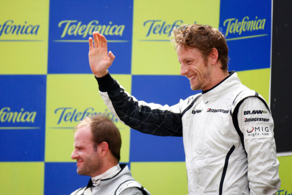 Circuit de Catalunya, Barcelona, Spain 10th May 2009 Jenson Button, Brawn GP BGP001 Mercedes, 1st position, and Rubens Barrichello, Brawn GP BGP001 Mercedes, 2nd position, celebrate on the podium. Portrait. Podium.  Photo: Glenn Dunbar/LAT Photographic  ref: Digital Image _O9T9047