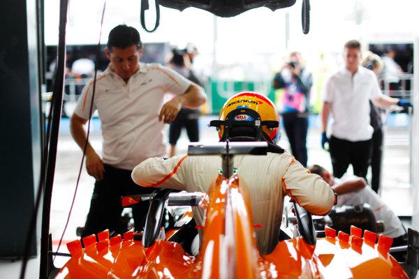 Fernando Alonso, McLaren, enters his cockpit.