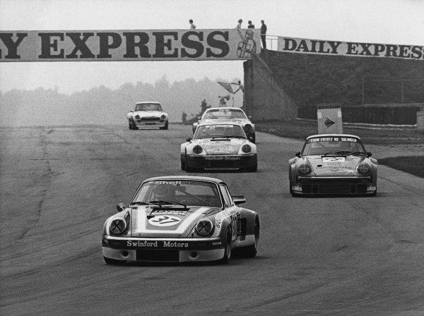 Silverstone, England. 9th May 1976. Rd 3.John Cooper/Nick Faure (Porsche Carrera RSR), retired, leads Lella Lombardi/Heinz Martin (Porsche 934 Turbo), 5th position and Kurt Simonsen/Kenneth Leim (Porsche Carrera RSR), 7th position, action. World Copyright: LAT Photographic.Ref:  B/WPRINT.