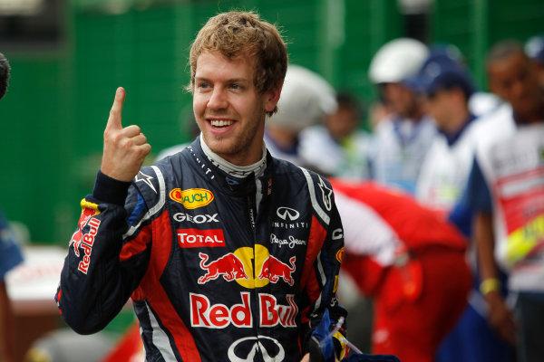 Interlagos, Sao Paulo, Brazil. 26th November 2011. Sebastian Vettel, Red Bull Racing RB7 Renault, celebrates pole in Parc Ferme. Portrait.  World Copyright: Andrew Ferraro/LAT Photographic ref: Digital Image _Q0C4183