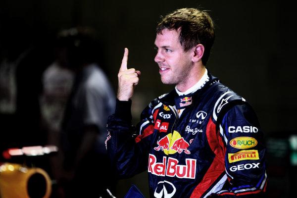 Marina Bay Circuit, Singapore.24th September 2011.Sebastian Vettel, Red Bull Racing RB7 Renault, celebrates pole. Portrait. World Copyright: Andy Hone/LAT Photographicref: Digital Image CSP28567