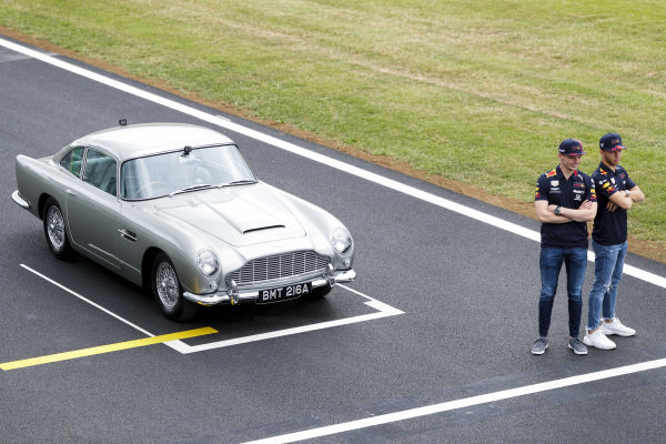 Max Verstappen, Red Bull Racing and Pierre Gasly, Red Bull Racing in a James Bond Aston Martin DB5