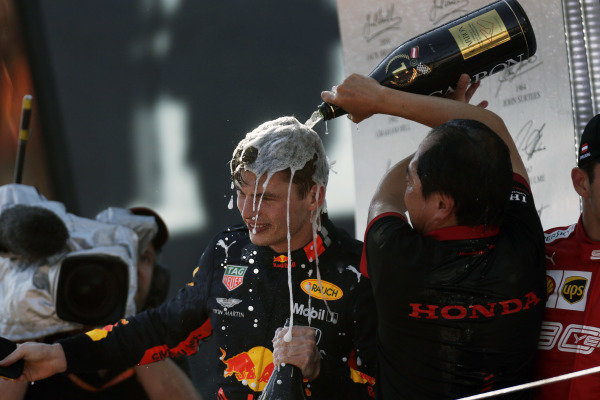 Toyoharu Tanabe, F1 Technical Director, Honda, pours Champagne over Max Verstappen, Red Bull Racing, 1st position, on the podium