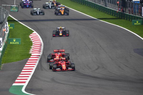 Charles Leclerc, Ferrari SF90, leads Sebastian Vettel, Ferrari SF90, Alexander Albon, Red Bull RB15, Carlos Sainz Jr., McLaren MCL34, and Lewis Hamilton, Mercedes AMG F1 W10, at the start