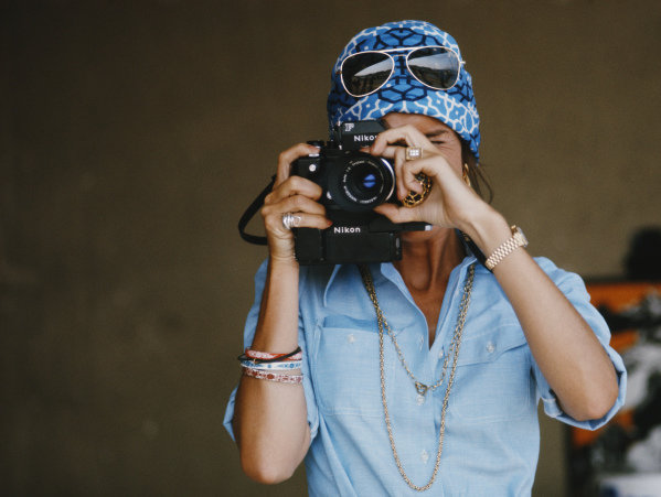 Helen Stewart takes a photograph with her Nikon F camera.