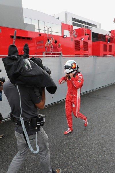 Sebastian Vettel (GER) Ferrari walks in after crashing out of the lead of the race