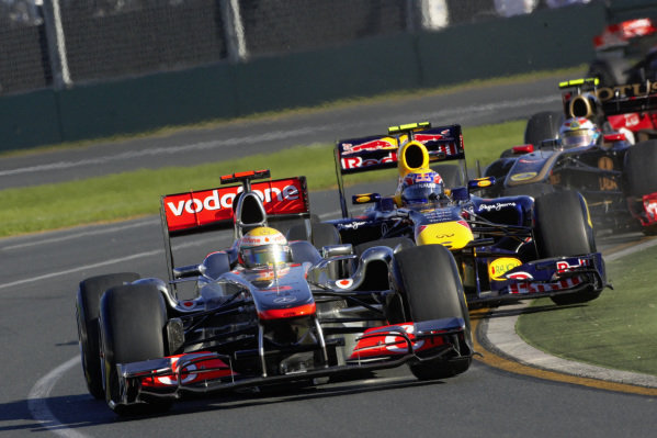 Lewis Hamilton, McLaren MP4-26 Mercedes, leads an oversteering Mark Webber, Red Bull RB7 Renault, and Vitaly Petrov, Renault R31.