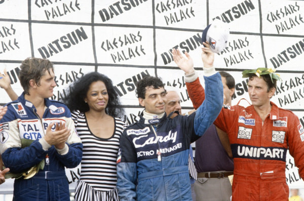 Michele Alboreto, 1st position, John Watson, 2nd position, Eddie Cheever, 3rd position, and Diana Ross on the podium.