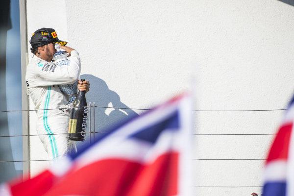 Lewis Hamilton, Mercedes AMG F1, 1st position, leaves the podium