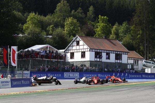 Charles Leclerc, Ferrari SF90, leads Sebastian Vettel, Ferrari SF90, Lewis Hamilton, Mercedes AMG F1 W10 and Valtteri Bottas, Mercedes AMG W10, as Kimi Raikkonen, Alfa Romeo Racing C38 is tipped into the air by Max Verstappen, Red Bull Racing RB15